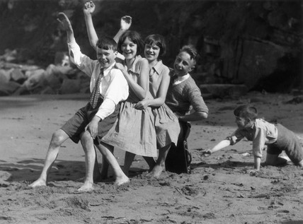 Children playing on a beach, c 1930s.