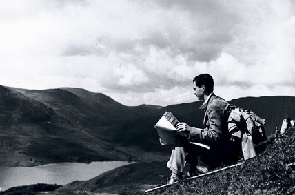 Rambler map-reading on a hill top, c 1930s.