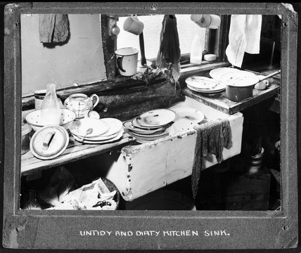 Dirty plates in the kitchen, 1947-1955.