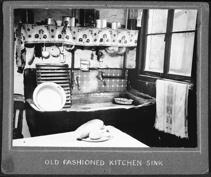 An untidy and dirty kitchen, 1947-1955.