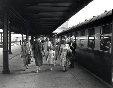 Pasengers at Rhyl Station, c 1950s.
