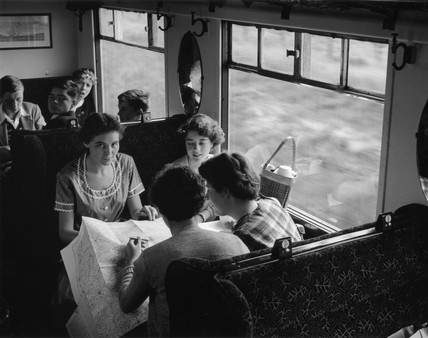 Senior girls in the compartment of a train en route for Norwich, June 1955.