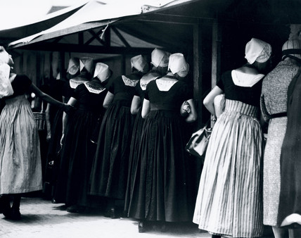 Women in traditional Dutch dres at a market, Holland, c 1920s.