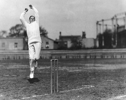 Bowler about to release the ball, c 1920s.