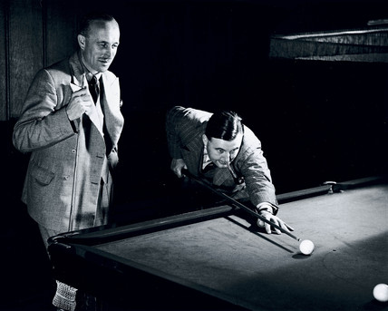 Playing billiards, c 1930s.