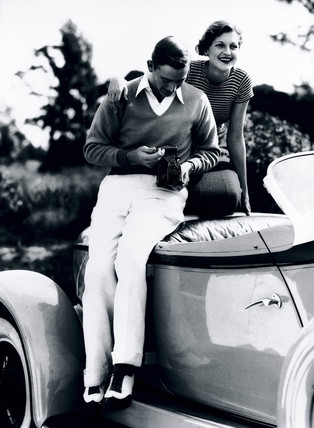 Young couple with a Kodak Series III camera, 1935.