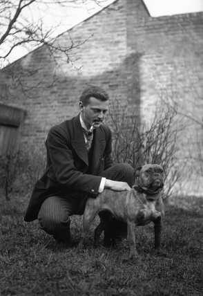 Edwardian man stroking a dog, c 1900s.