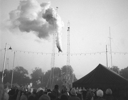 Smoke billowing from a circus stuntman as h