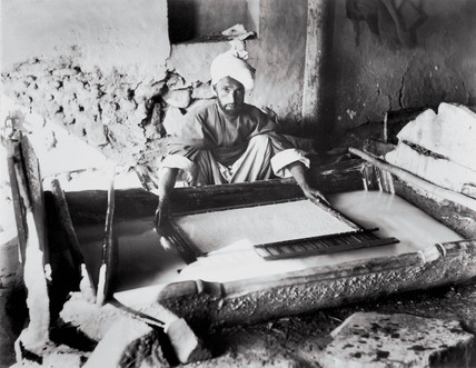 Vatman forming a sheet of paper in Kashmir, India, 1917.