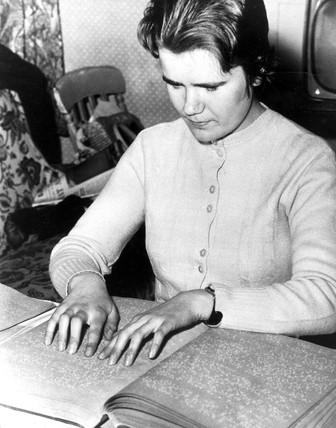 Blind girl reading Braille, 1962. 'Eighteen