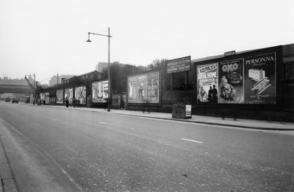 Billboards outside Waterloo station, London, 3 March 1950.