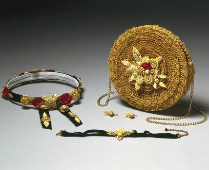 Twisted straw handbag and jewellery, c 1995.
