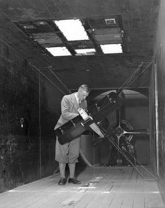Testing the aerodynamics of a biplane, 6 May 1932.