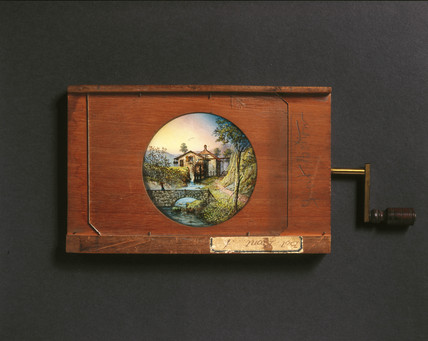 Combined lever and rotary magic lantern slide, 19th century.