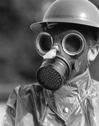 Man wearing a gas mask, c 1930s.