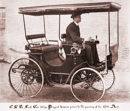 C S Rolls, driving his first car, 1896.