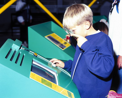 Boy with interactive during 'Buckyballs and Beyond' Exhibition, May 1998.