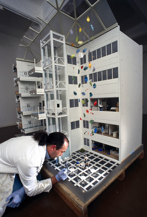 Cleaning a model of the Chelsea and Westminster Hospital, 1998.