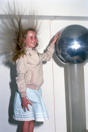 Girl with Van der Graaff generator, 1998.
