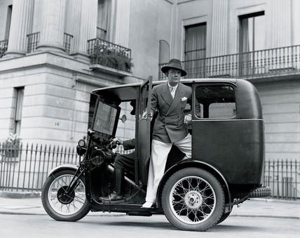 Man posing on a three-wheeler taxi, 27 June 1932.