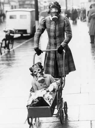 Mother and child wearing their gas masks, Southend, 29 March 1941.
