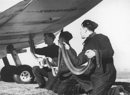 Soldiers loading a Spitfire with ammunition