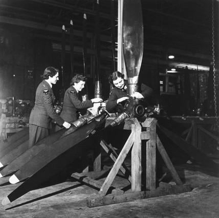 Women repairing damaged aircraft propellers