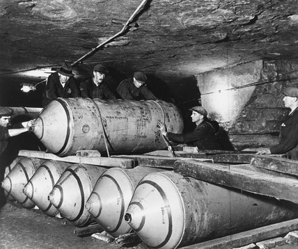 Men working in a Royal Air Force bomb store