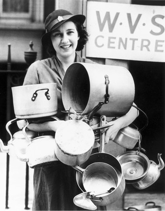 Woman with aluminium pans, World War Two, 10 July 1940.