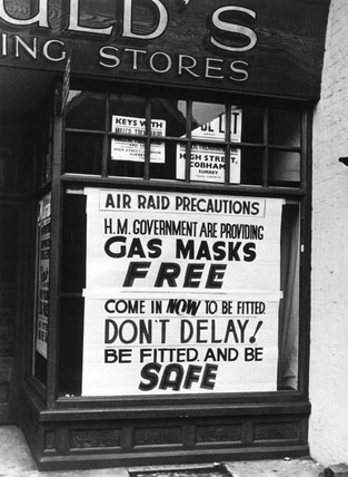 Poster in shop window advertising gas masks, 1939-1945.