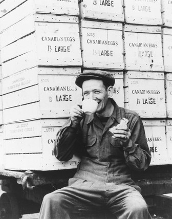 Worker drinking tea, London, World War Two, 27 September 1946.