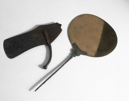 Ancient Egyptian bronze razor and mirror, 800 BC-100 BC.
