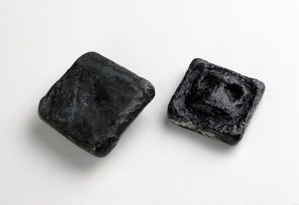 Two ancient Greek lead weights, c 300 BC.