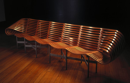 Compresed wooden bench designed by Jane Dillon, c 1997.