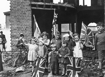 Children waving flags on VE Day, 8 May 1945