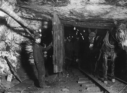 Trapper boy in Pennslyvania coal mine, c 1910.
