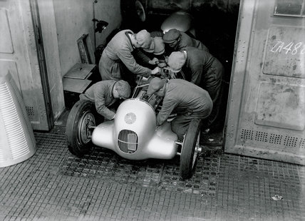 Mechanics working on a Mercedes-Benz racing car, Berlin, 1934.