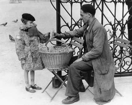 Peanut seller, Paris, c 1930s. Photograph b