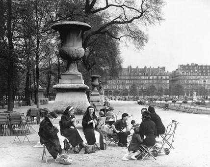 Nursemaids and children in a a park, Paris,