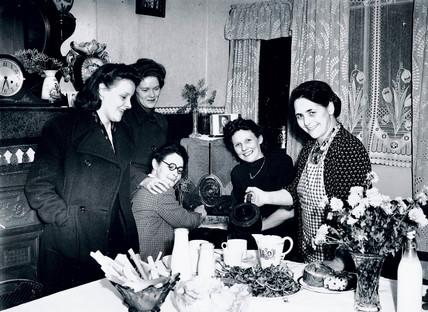 Landlady welcoming her guests at teatime, 29 October 1945.