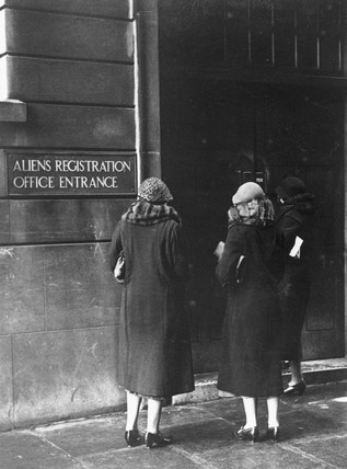 Three women outside the 'Alien Registration Office entrance', late 1920s.
