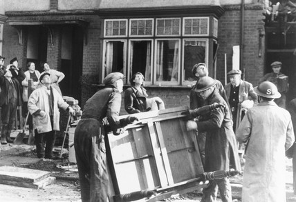 ARP men salvaging furniture from a damaged house, 1941.