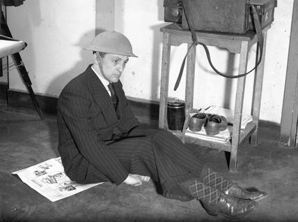 Edward G Malindine wearing a tin helmet, 29