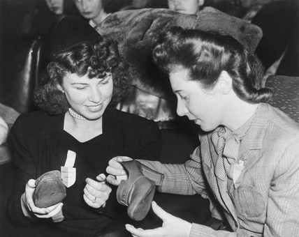 GI brides admiring new stockings and shoes, 17 December 1945.