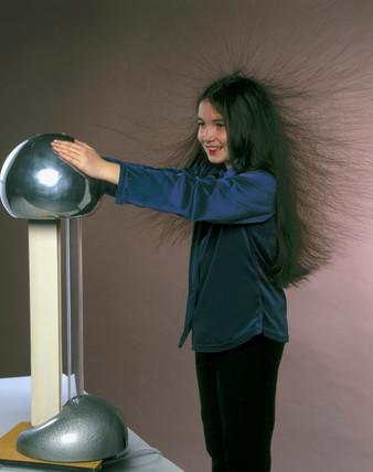 Girl with Van der Graaff generator, 1998.