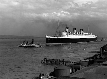 Cunard's White Star liner 'Queen Mary' under tow on the river Clyde, 1936.