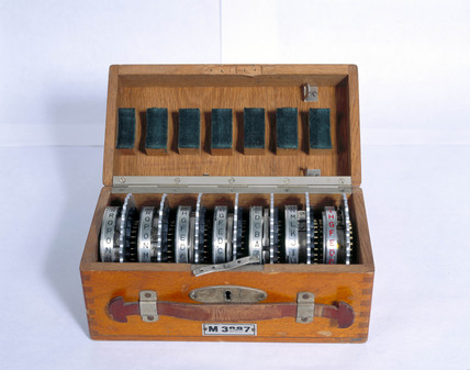 Box containing rotors for the four-rotor German Enigma machine, MK 4, 1942.