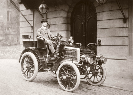 C S Rolls with his 12 hp Panhard motor car, 1900.