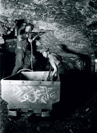 Miners using a pneumatic drill, Rhondda Valley, South Wales, 25 June 1931.