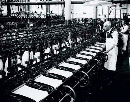 Man working a knitting machine, 18 April 1931.